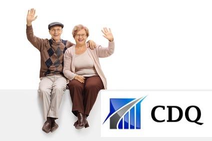 Joyful senior couple sitting on a panel and waving isolated on white background